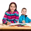 Two happy kids learn to draw together — Fotografia Stock  #75072875