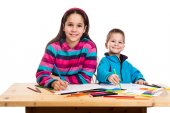 Two happy kids learn to draw together — Stock Photo
