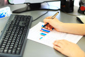 Business Woman Writing with pen in the office — Stock Photo
