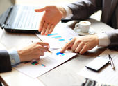Image of male hand pointing at business document during discussion at meeting — Stock Photo