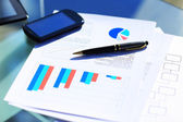 Financial charts on the table with tablet and pen — Zdjęcie stockowe