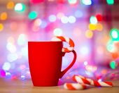 Mug Of Tea Or Coffee. Sweets. Christmas Decorations. Red Balls And Bells. Wooden Background — Stock Photo