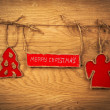 The inscription with Christmas on wooden background with Christmas tree and angel — Stock Photo #58921309