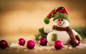 Christmas background with Christmas tree and snowman on a rustic wooden board — Stock Photo
