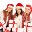 Three happy girls with Christmas gifts and decorations — Stock Photo #59180717