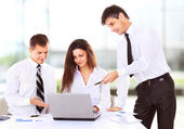 Business, technology and office concept - smiling female boss talking to business team — Fotografia Stock