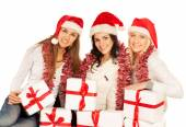 Three happy girls with Christmas gifts and decorations — Stock Photo