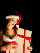 Santa woman opening the magical Christmas present box — Stock Photo