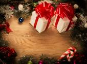 Green fir branches on the wooden floor with gifts with Christmas decoration — Stock Photo