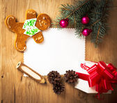 Christmas card: blank, vintage rural gift and Christmas tree branch on wooden background with gift — Стоковое фото