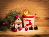 Mug Of Tea Or Coffee. Gift with red ribbon and . Sweets And Spices. Christmas Decorations. Wooden Background — Stock Photo