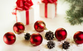 Gifts on a white background with Christmas balls — Stock Photo