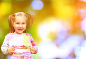 Cute little girl on the meadow in summer day — Stock Photo