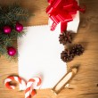 Christmas card: blank, vintage rural gift and Christmas tree branch on wooden background with gift — Stock Photo #64603053