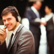 Happy young man working at callcenter, using headset — Stock Photo #66170853