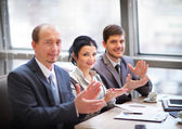 Close-up of business people clapping hands. Business seminar concept — Stock Photo