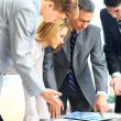 Business team working on their business project together at office — Stock Photo #67537607