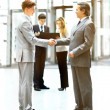 Business people shaking hands, finishing up a meeting — Stock Photo #67537613