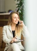 Young woman in office with mobile phone — Foto de Stock