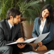 Businessman And Businesswoman Meeting In Modern Office — Stock Photo #77496956