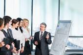 A group of businessmen discussing the policy of the company — Stock Photo