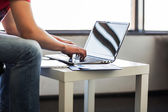 The hands of men working in stylish and classy laptop in the work — Stock Photo