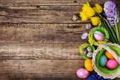Baskets with colored eggs — Stock Photo