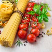 Pasta spaghetti, cherry tomatoes and spices, ingredients — Stock Photo