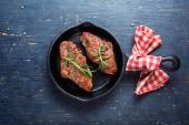 Cast-iron pan with meat — Stock Photo