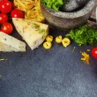 Italian food, pasta, cheese, vegetables and spices — Stock Photo #78638420