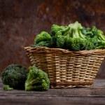 Fresh green broccoli in a basket — Stock Photo #81123620