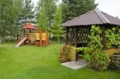 Wooden children playground in summer park — Stockfoto