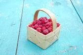 Fresh summer raspberry fruit  in wooden small basket — Foto de Stock