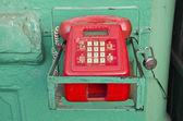 Retro red telephone in asia street, India — Stock Photo