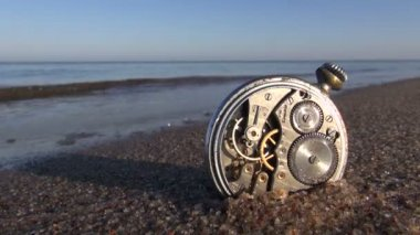 Time and sea concept -  pocket vintage clock on sea beach sand — Stock Video
