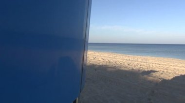 Summer early morning empty sea resort beach with shadows — Stockvideo