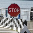 Road sign stop in port near sea — Stock Photo #58477629