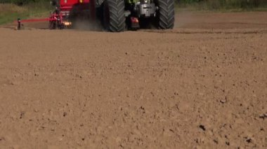 Modern agriculture tractor seeding crop grain on farm field soil — Stock Video