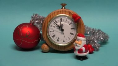 Beautiful Santa Claus toy walking near Christmas New year decorations and clock — Stock Video
