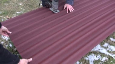 Worker cut with electric saw roof  corrugated sheet — Stock Video