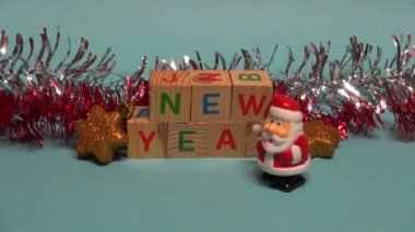 Beautiful Santa Claus toy walking near Christmas New year decorations — Стоковое видео