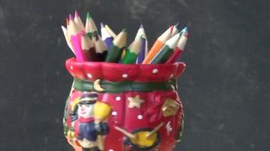 Rotate set colorful pencil in decorative ceramic vase — Stock Video