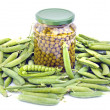 Canned green pea in glass jar and fresh pods isolated on white — Stock Photo #61260877