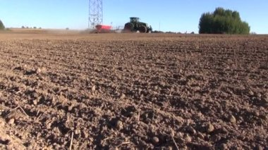 Agriculture tractor on  farm field seeding  grains — Stock Video