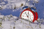 Vintage new year clock alarm-clock on snow — Stock Photo