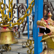 Old bell and dragon head in asia temple, Nepal — Stock Photo #63185763
