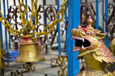 Old bell and dragon head in asia temple, Nepal — Stock Photo