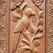 Ornate carved wood door fragment with bird relief — Stock Photo #63288755