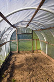 Old plastic grenhouse  hothouse in farm — Stock Photo