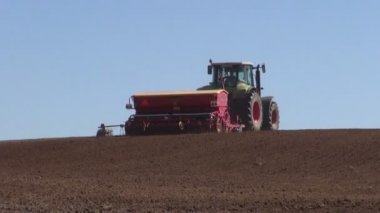 Agricultural tractor sowing cultivating farm field — Stock Video